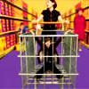 darth_snarky: Sadie Frost pushes Jarvis Cocker in a shopping cart. Or trolley 'cuz they're Brits. (I can't see anyone else smiling in here)