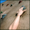 taennyn: a human hand reaching for a climbing hold (humans make bad goats)