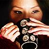 syntheid: [Elementary] Watson drinking tea looking contemplative (~ dreamwidth)