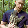 sarken: emo anderson cooper holding a sloth ([pundits] a bit too heavy)