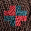 pinesandmaples: A blue and red cross on a brown background, all made of yarn. Based on a mitered square. (knitting: square)