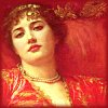 trixieleitz: she wears red and reclines on red pillows, staring lazily at you (passion)