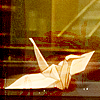 fandomonymous: A paper crane with grains of sugar nearby. (GitS paper crane)