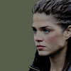 grounder_mod: 3/4 view of octavia, khaki background, doing her intense jawline glary thing (Default)