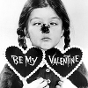 "antigone: Lisa Loring as Wednesday Addams, with a spider on her nose and two hearts that read ""be my valentine"" (be my valentine)"