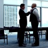 slash4femme: Wesley and Fisk from the tv series stand in the dining room of Fisk's apartment. Wesley is doing Fisk's tie (Daredevil: Fisk/Wesley)