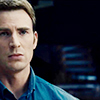 longwhitecoats: Steve Rogers in a blue button-down shirt looking serious (Steve serious)