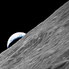 fish_echo: Earthrise behind a lunar crater rim (Space-Earthrise from crater rim)