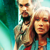 omg_wtf_yeah: Ronon stands behind Teyla, both appearing on guard. (SGA - Teyla and Ronon or Teynon for shor)
