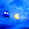 rising: a blue pacman ghost illustration chasing pacman (the cadre: pacman ghost)