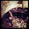 thedivinegoat: A red tinted, desaturated photo of a new restored waterwheel and penstock. (My Photo - Waterwheel)
