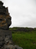 eire_roads: Photo of part of a ruined wall of a building with a field behind it. (Aran Island)