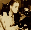 cloudsinvenice: sepia photo of man at typewriter with cats on his shoulders and desk (caturday)