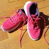syderia: hot pink running shoes on a hardwood floor (exercising)