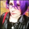 tajasel: Katie, with a purple wig on. (Random: free hugs)