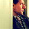 argylepiratewd: Side-profile of a man in a doorway with a serious expression (Adam--Dramatic)
