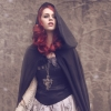 undeadfiredoll: Red Haired woman in a hooded cape. (Lnlaal)