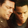 dorinda: John Kennex and Dorian with their heads very close, both looking down, very serious. (john_dorian_amber)
