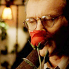trialia: Anthony Stewart Head as Rupert Giles with a rose to his lips and a smile behind it. (buffy] giles - rose)