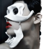 outlineofash: A woman with red lipstick wears a two-piece mask shaped after a skull. (Fiction - The Thirteenth Rib II)