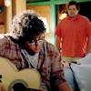 mona: screencap from huge of trent awkwardly, awe-struck-ly watching ian play guitar. (sad jock)