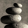 rhi: four stones of ascending size, stacked in a careful curve. (balance)