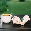rhi: A cup of tea, an open book, and a mint leaf to sniff or mark my place.  Reading. (reading)