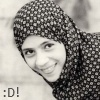 surexit: A brightly smiling girl in a spotted headscarf. (:D)