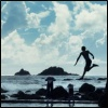 surexit: A silhouetted figure leaping into the sea. (leap of faith)