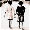 surexit: Two young girls walking away from the camera holding hands. (let's stick together)