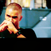 derek_morgan: (seated stare hands folded ifo mouth)