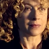 trialia: Blonde River Song, played by Alex Kingston, smiling calmly with a curl over one eye. (who] river - calm)