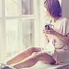 monsterboy: young woman sitting in window with coffee ([wade] coffee)