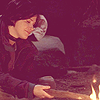 "heartisanawesomepower: A woman lighting a campfire with a chunk of wood. (Screencapped from ""In Dino Veritas"", Sliders episode 2x07.) (lighting fire)"