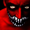 outlineofash: A man painted in red and wearing facepaint that resembles wide jaws and sharp teeth. (Fierce - Teeth)