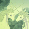 outlineofash: Still from the movie The Last Unicorn, where two unicorns cross horns lovingly. (Media - Unicorns)