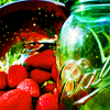 chalcopyrite: A pile of strawberries next to a preserving jar (food: strawberry jam)