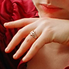 rosefox: My hand with my wedding ring prominently displayed. (wedding ring)