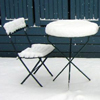 rosefox: A chair and table covered in snow. (Bryant Park)