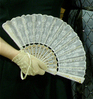 rosefox: My lace-gloved hand and lace fan. (costume, dancing)