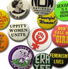 rosefox: Lots of buttons with feminist slogans and images. (feminism)