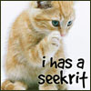"""jamethiel: A cat has a paw to its mouth. Text """"I has a seekrit"""" (seekrit!lolcat)"""