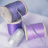 jamethiel: Three reels of cotton in varying shades of purple, with a needle and a thimble (Sewing!)