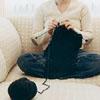 jamethiel: A woman knits on a sofa (Knitting)