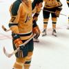 fyborg23: a shot of three guys in yellow and green hockey uniforms on ice (hockey, california golden seals)