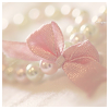 softness: pink ribbon on a pearl necklace (pearls)