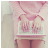 softness: girl in pink sweater with pink laptop on her lap, top view downward on the laptop (laptop)