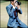 highlander_ii: Chris Pine kneeling on the floor holding a camera to his face (Default)