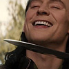 calime: TDW Loki smirking with Sif's blade at throat (Loki little shit smile)