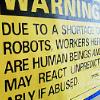 strange_loop: Due to a shortage of robots, workers here are human beings and may react unpredictably if abused. (robot shortage)